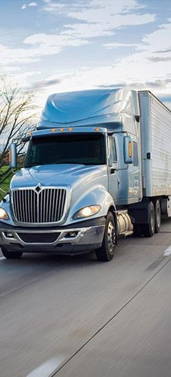 Dry Van truck moving down highway