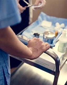 Nurse prepping medical supplies
