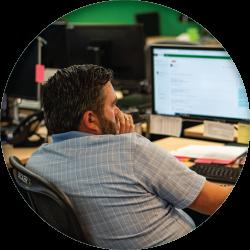 Becker Logistics associate communicating with customer