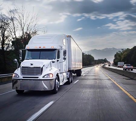Truck running a quality logistics service on the open road