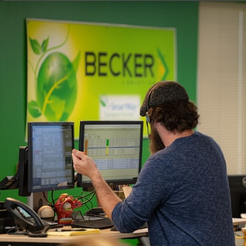 Becker employee setting up an EDI to ensure Low Cost Freight Shipping
