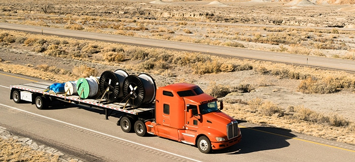 flatbed shipping down the highway