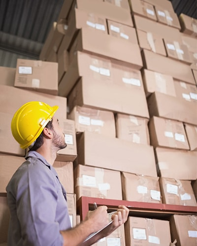Warehouse worker busy and looking for a High Quality 3PL Shipping Service